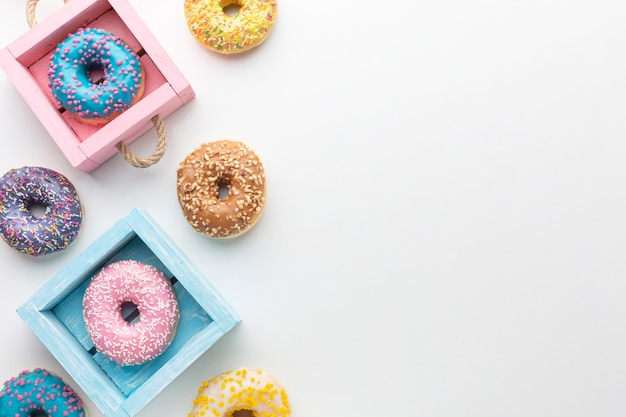 Glazed donuts in boxes copy space Free Photo