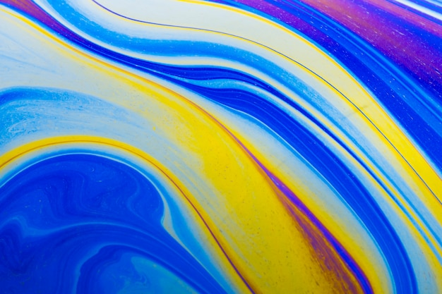 Gleaming wavy blue and yellow abstract background Free Photo
