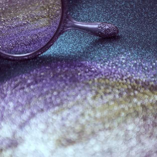Glitter bokeh lights background and a mirror Free Photo