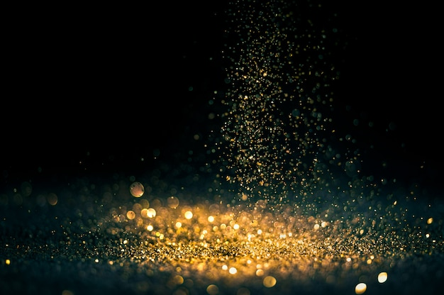 Glitter lights grunge background, gold glitter defocused abstract twinkly gold lights background. Premium Photo