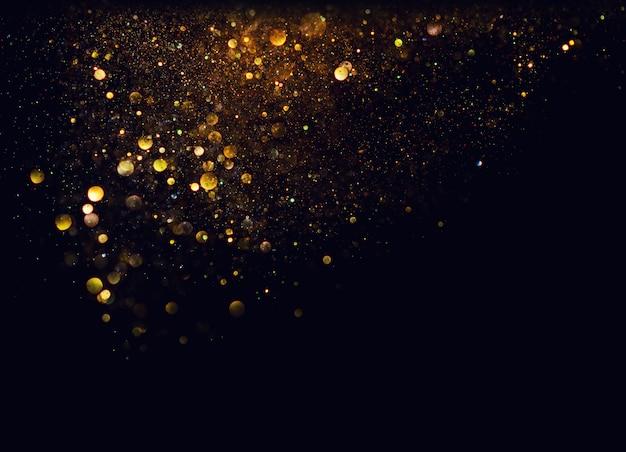 반짝이 빈티지 조명 배경. 금색과 검은 색. 집중 프리미엄 사진
