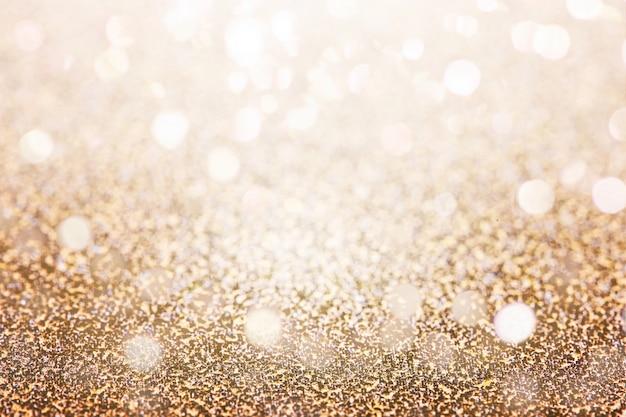 Glittery gold background Free Photo