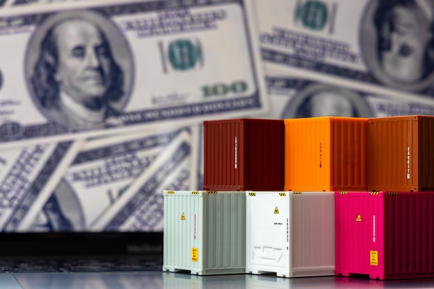 Global business container cargo ship in import export business logistic, company shipping and logistics technology business industrial, container on computer laptop notebook dolla money background. Premium Photo