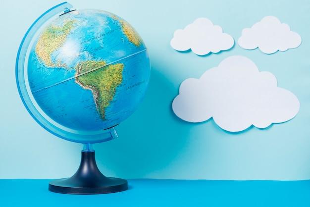 Globe near paper clouds 23 2147772327