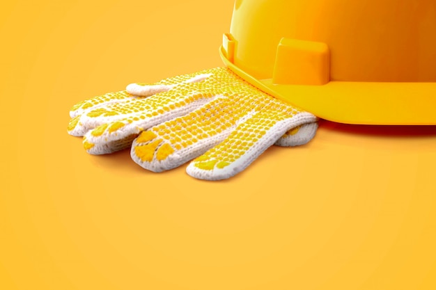 Glove and safety helmet in vibrant color Premium Photo