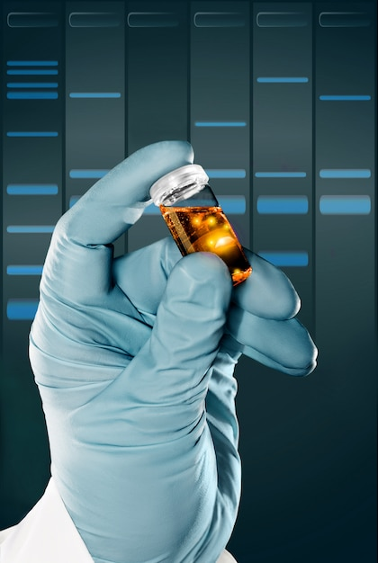 Gloved hand holds a liquid sample in plastic vial Premium Photo