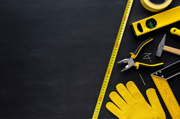 Gloves and tools with copy space Free Photo