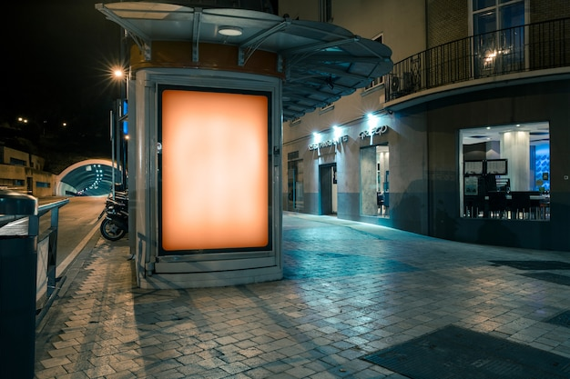 Glowing billboard for the advertisement on the sidewalk Premium Photo
