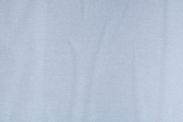 Glued paper textured gray wall on a non-woven base. creative abstract background. Premium Photo