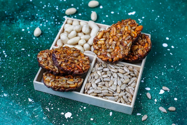 Gluten free nut candied cookies with chocolate,peanut and sunflower seeds,top view Free Photo