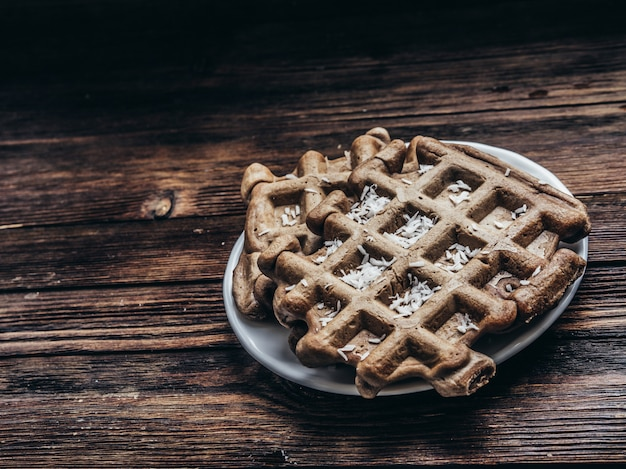 Gluten free waffles with coconut chips Premium Photo