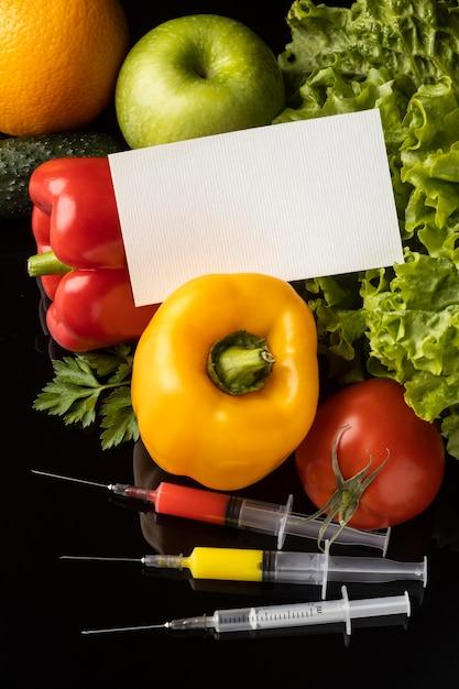 Alimento modificato chimico ogm e biglietto da visita dello spazio della copia Foto Gratuite