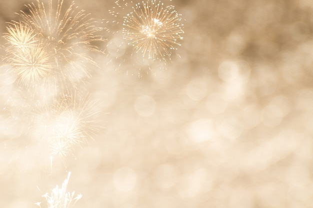 Gold bokeh with firework for new year or celebrate background Premium Photo