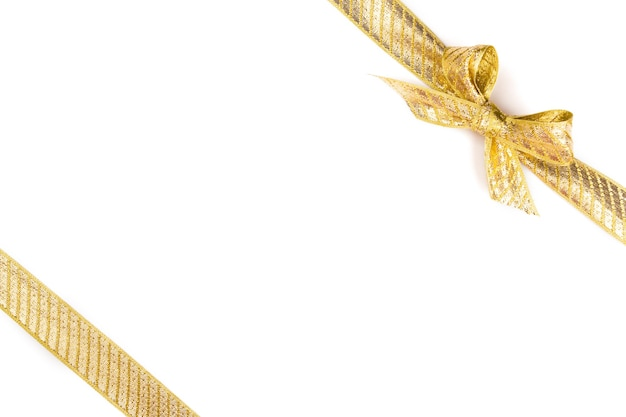 Gold bow isolated on white surface Premium Photo