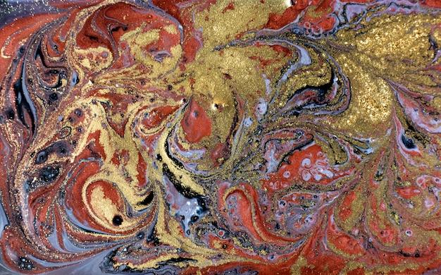 Gold, bronze and black marbling background. golden marble liquid texture. Premium Photo