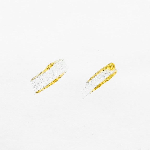 Gold brush with glitter Free Photo