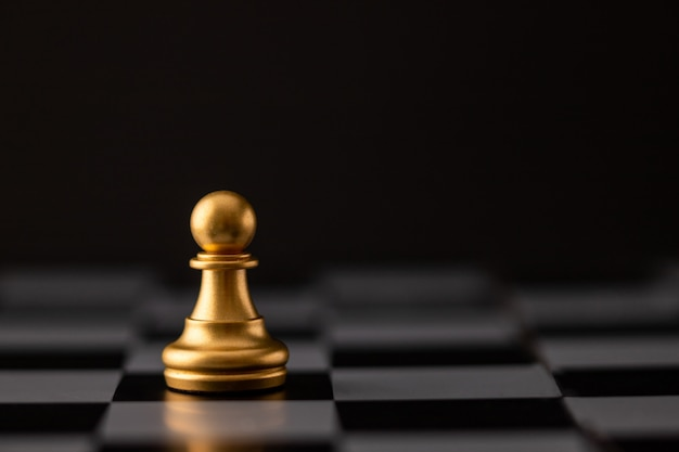Gold chip on the chessboard Premium Photo