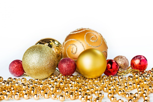 Gold christmas balls isolated Free Photo