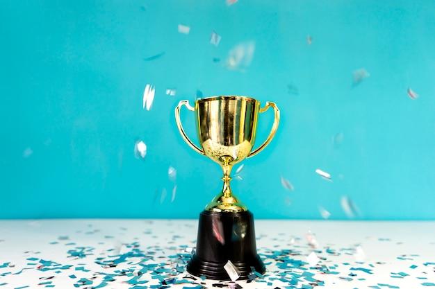 Gold cup on background concept celebration Premium Photo