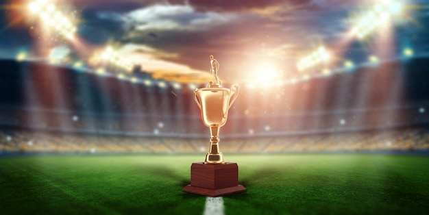 Gold cup on the background of the stadium Premium Photo