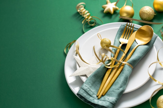 Gold cutlery served on plate for christmas dinner Free Photo