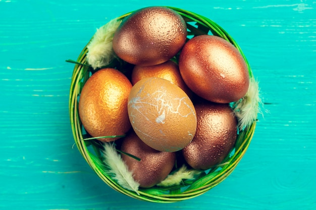 Gold easter eggs on wooden table Premium Photo