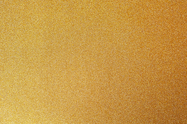 Gold festive background, close-up. Premium Photo