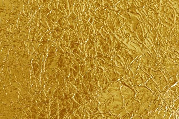 Gold foil leaf shiny texture Premium Photo