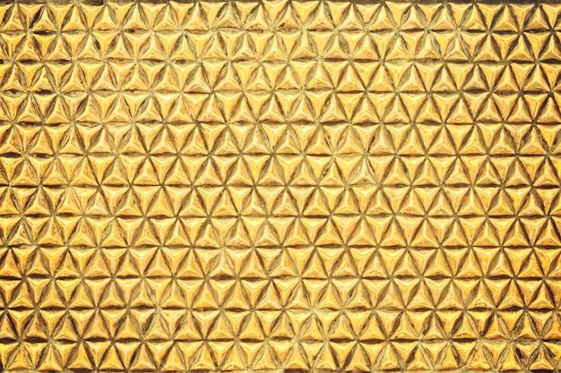Gold geometric texture metal wall background Premium Photo