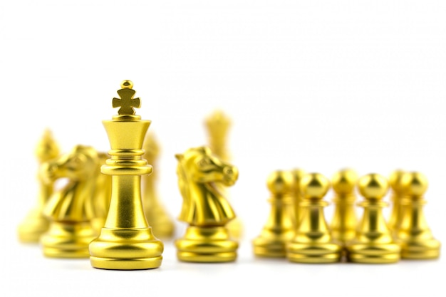 Gold king in chess game with concept business victory or decision the path to success. Premium Photo