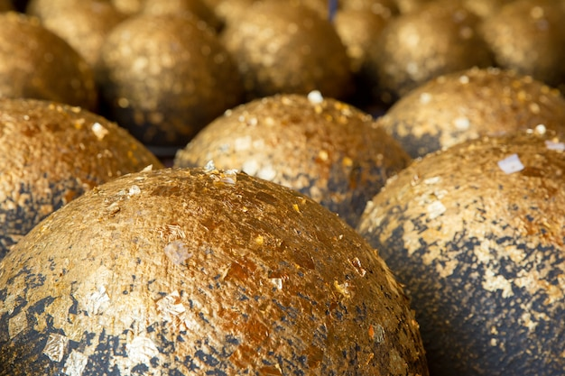 Gold leaf sheet on marker spheres in the temple compound, focus selective Premium Photo