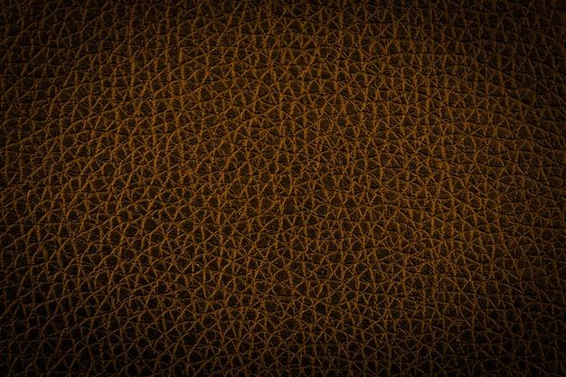 Gold leather abstract texture background. dark tone Premium Photo