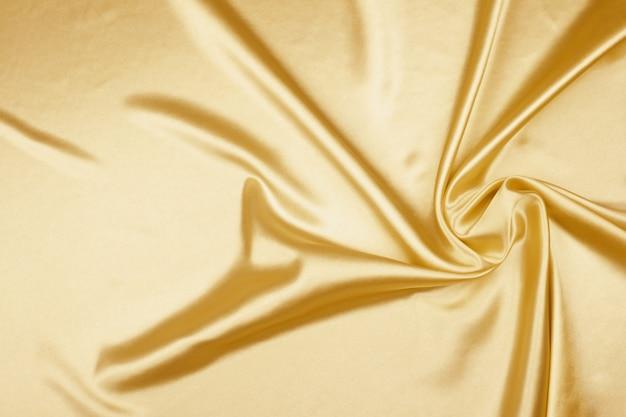 Gold luxury satin fabric texture for background Premium Photo