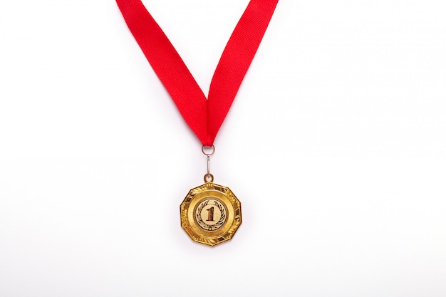 Gold medal with red ribbon on white background. isolated. Premium Photo