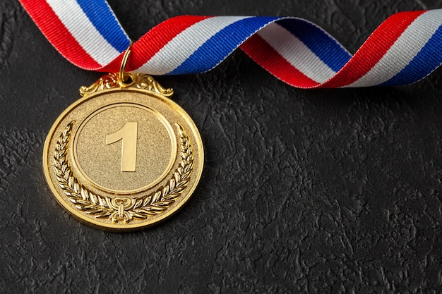 Gold medal with ribbons. award for first place in the competition. prize to the champion Premium Photo