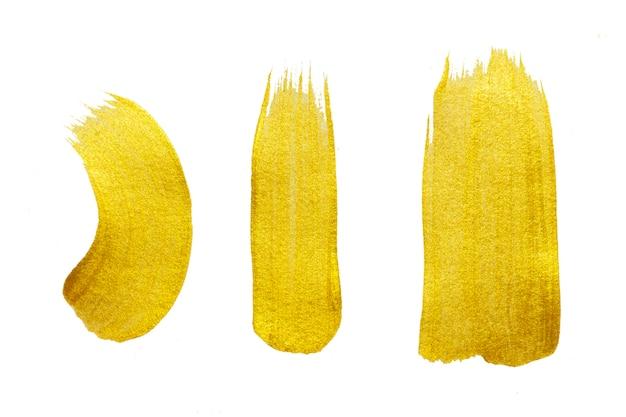 Gold paint brush stroke. abstract gold glittering textured art illustration. Premium Photo