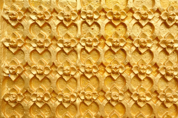 Gold patterned thai art on wall in temple Premium Photo