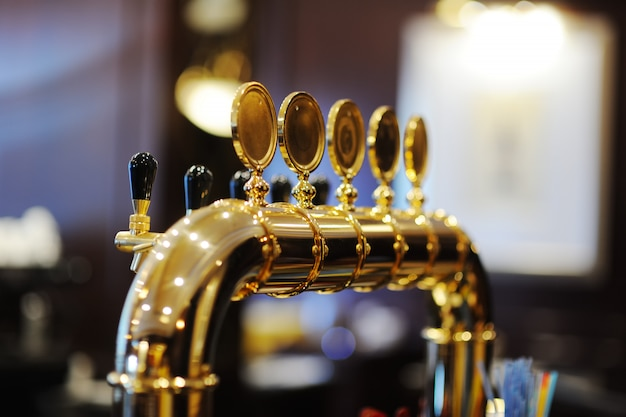 Gold plated beer tap for dispensing beer closeup Premium Photo