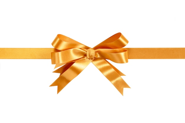 Gold ribbon and bow isolated against white. Free Photo
