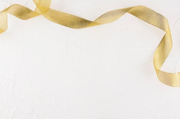 Gold ribbon on light table Premium Photo