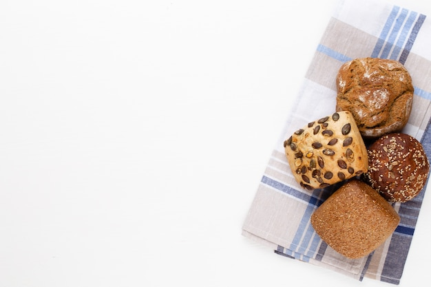 Gold rustic crusty loaves of bread and buns on wooden table. still life captured from above top view, flat lay. Premium Photo