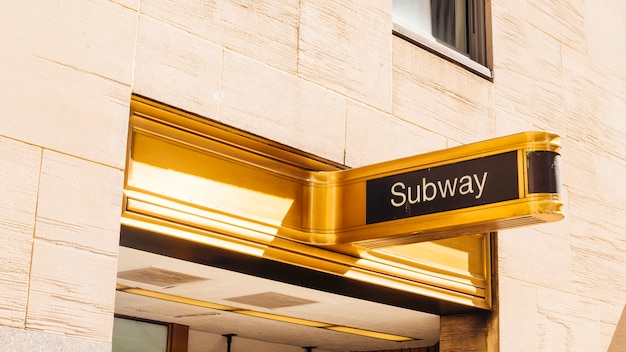 Gold sign board of subway Free Photo