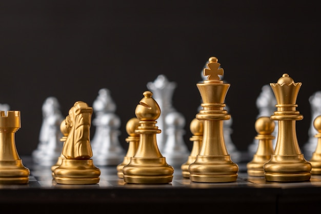 Gold and silver chess group Premium Photo