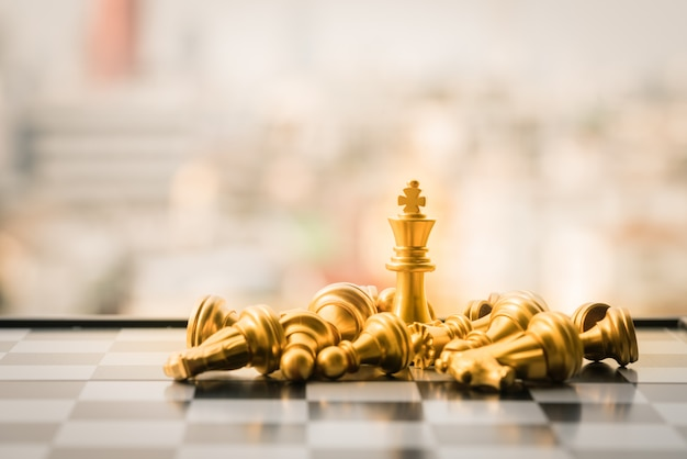 Gold and silver king of chess setup on city background . Premium Photo