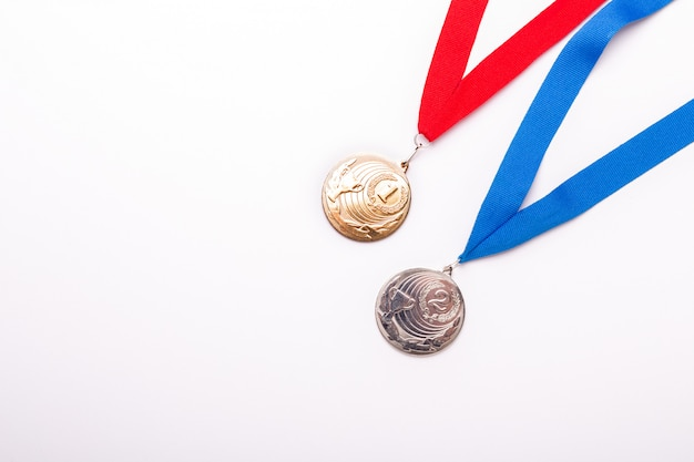 Gold and silver medals with ribbon on white background. Premium Photo