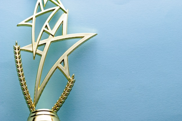 Gold star trophy for a competition winner Premium Photo