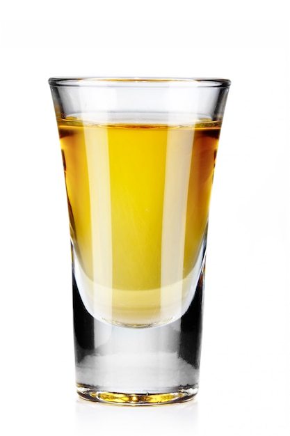 Gold tequila shot isolated on white Premium Photo