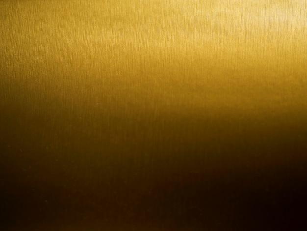ゴールドのテクスチャ背景のグラデーション 無料写真
