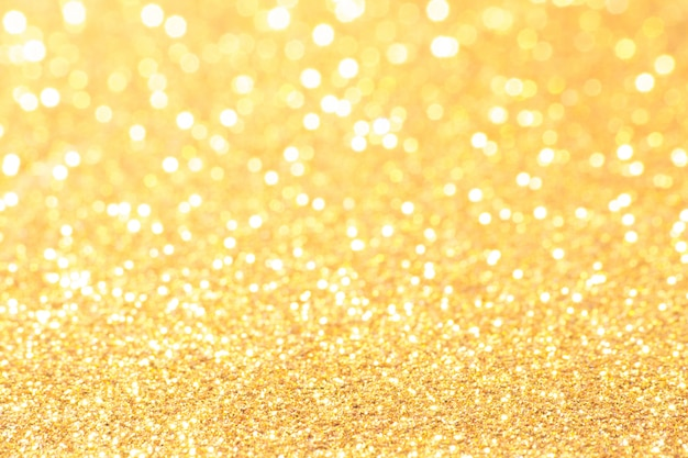 Gold and white bokeh lights defocused. abstract background Premium Photo