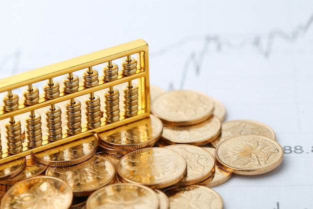 Golden Abacus with Chinese rmb gold coins as background Free Photo
